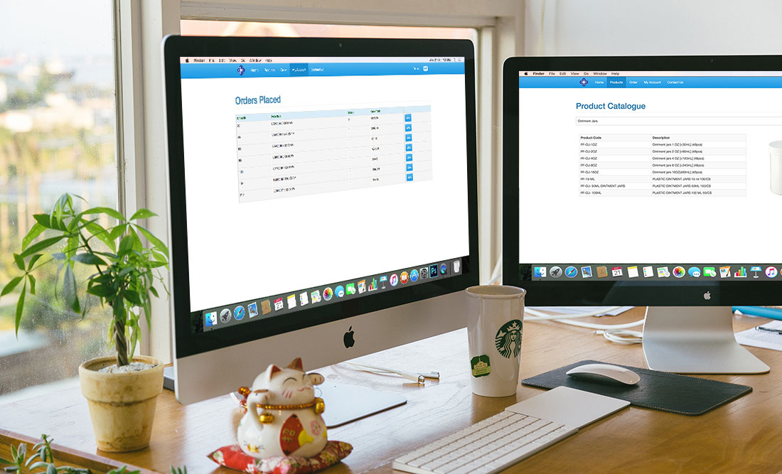 Dual-screen mac setup displaying pharma site